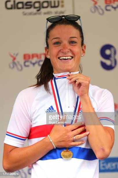 Lizzie Armitstead of Boels Dolmans Cycling Team celebrates on the podium after winning the 2013 National Womens Road Race Championships on June 23,...