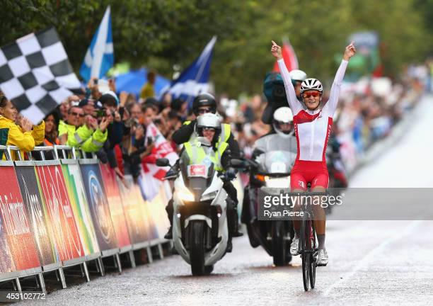 Lizzie Armitstead of England celebrates as she crosses the line to win the Women's Cycling Road Race during day eleven of the Glasgow 2014...