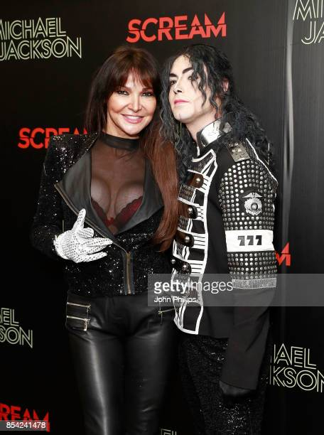Lizzie Cundy and a Michael Jackson impersonator attend the Michael Jackson's 'Scream' album launch at Odeon Covent Garden on September 26 2017 in...