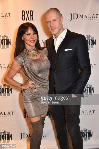 Lizzie Cundy and JeanDavid Malat attend the opening of 'FRAME' an exhibition of photographs by Alan Chapman at BXR London on March 6 2018 in London...