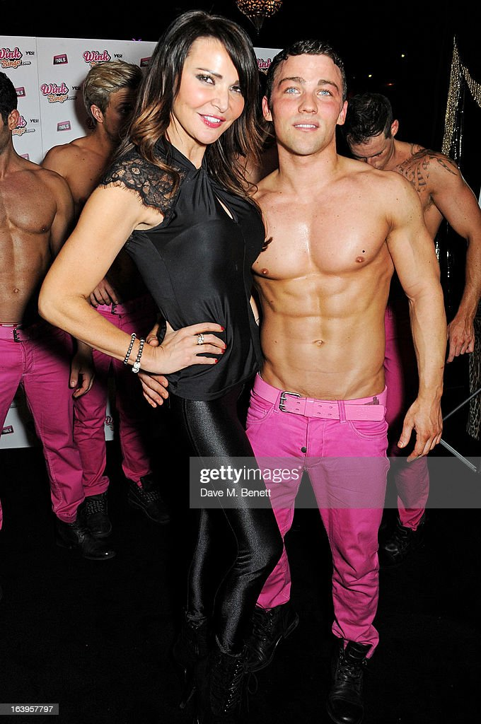 Lizzie Cundy (L) poses with one of the Dream Idols at Wink Bingo's Gentle Woman's Night featuring a performance from The Dream Idols at Peter Stringfellow's Angels Club on March 18, 2013 in London, England.
