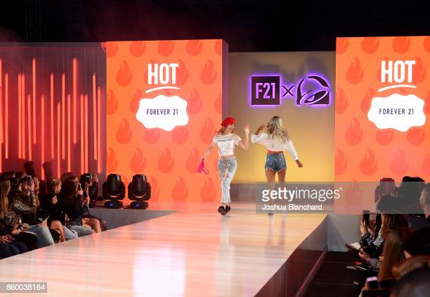 Lizzie Darden and Rebecca Zamolo walk the runway at a celebration of the Forever 21 x Taco Bell Collection and the fans who inspired it at DTLA...