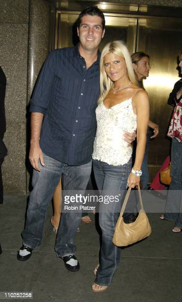 Lizzie Grubman and boyfriend Chris Stern during Olympus Fashion Week Spring 2006 Baby Phat Fashion Show Arrivals at Radio City Music Hall in New York...