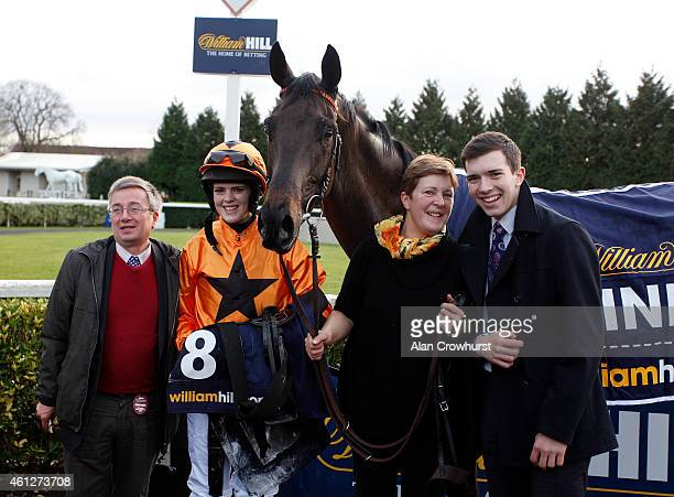 Lizzie Kelly and Tea For Two pose with Jane Williams after winning The William Hill Lanzarote Hurdle Race at Kempton Park racecourse on January 10,...