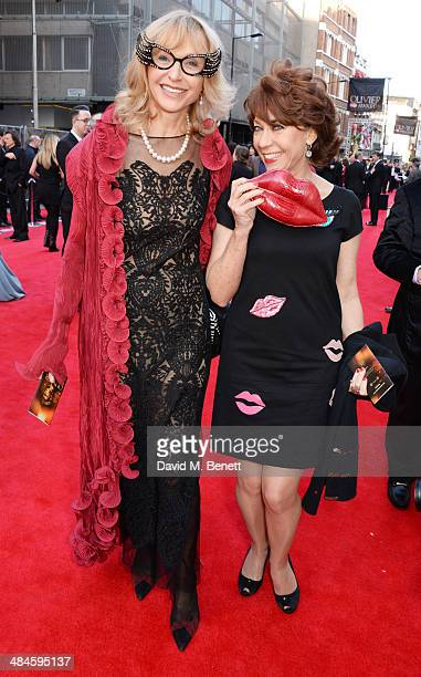 Lizzie Spender and Kathy Lette attend the Laurence Olivier Awards at The Royal Opera House on April 13, 2014 in London, England.