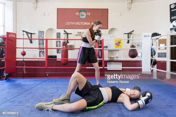 Lizzie Stanton and Sofia Greenacre of Tramp Production pose in the ring during a photocall to promote the show 'The Sweet Science' at Leith Victoria...