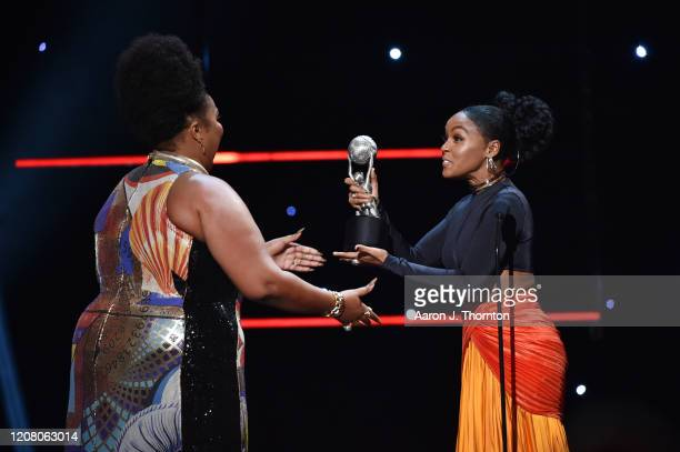 Lizzo accepts Entertainer of the Year award from Janelle Monae onstage during the 51st NAACP Image Awards Presented by BET at Pasadena Civic...