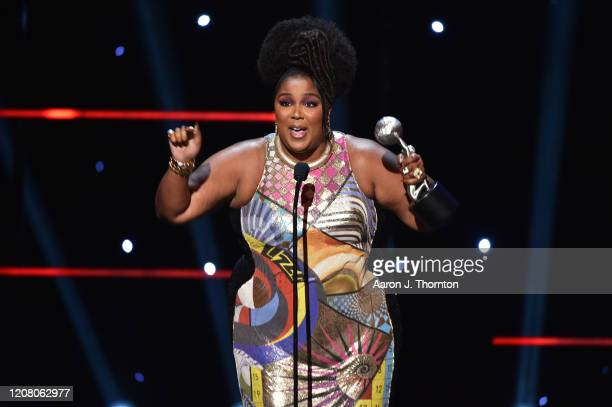 Lizzo accepts Entertainer of the Year award onstage during the 51st NAACP Image Awards Presented by BET at Pasadena Civic Auditorium on February 22...