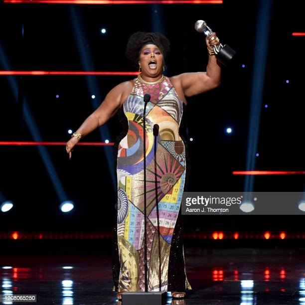 Lizzo accepts the Entertainer of the Year award onstage during the 51st NAACP Image Awards Presented by BET at Pasadena Civic Auditorium on February...