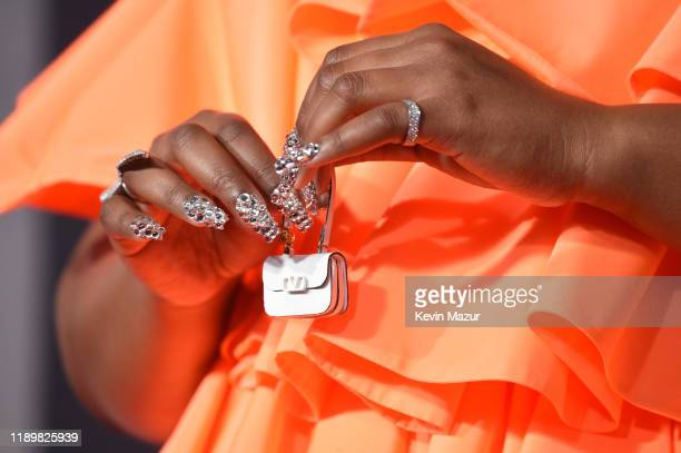 Lizzo purse and manicure detail attends the 2019 American Music Awards at Microsoft Theater on November 24 2019 in Los Angeles California