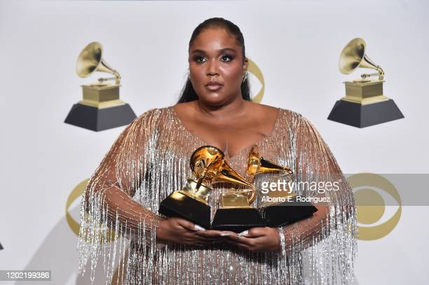 """Lizzo, winner of Best Pop Solo Performance for """"Truth Hurts"""", Best Traditional R&B Performance for """"Jerome"""" and Best Urban Contemporary Album for..."""