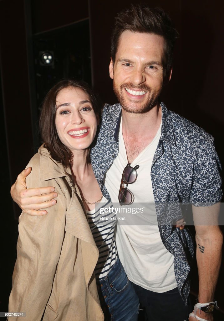 Lizzy Caplan and husband Tom Riley pose backstage at the hit musical based on the film 'Mean Girls' on Broadway at The August Wilson Theater on May 26, 2018 in New York City.