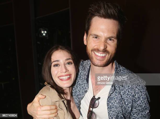 Lizzy Caplan and husband Tom Riley pose backstage at the hit musical based on the film Mean Girls on Broadway at The August Wilson Theater on May 26...