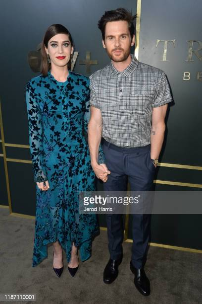 Lizzy Caplan and Tom Riley arrive at the premiere of Apple TV+'s 'Truth Be Told' at AMPAS Samuel Goldwyn Theater on November 11, 2019 in Beverly...