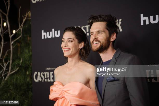 """Lizzy Caplan and Tom Riley arrive at the premiere of Hulu's """"Castle Rock"""" season 2 at AMC Sunset 5 on October 14, 2019 in Los Angeles, California."""