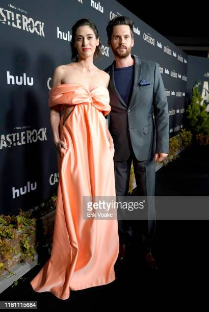 """Lizzy Caplan and Tom Riley attend Hulu """"Castle Rock"""" Season 2 Premiere at AMC Sunset 5 on October 14, 2019 in West Hollywood, California."""