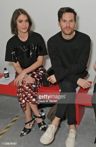 Lizzy Caplan and Tom Riley attend the Christopher Kane show during London Fashion Week February 2019 on February 18, 2019 in London, England.