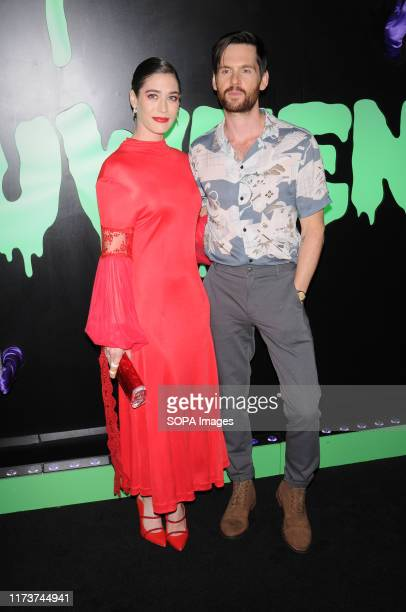 Lizzy Caplan and Tom Riley attend the Huluween Celebration held at Huluween HQ in New York City