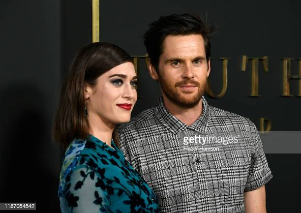 """Lizzy Caplan and Tom Riley attend the Premiere Of Apple TV+'s """"Truth Be Told"""" at AMPAS Samuel Goldwyn Theater on November 11, 2019 in Beverly Hills,..."""