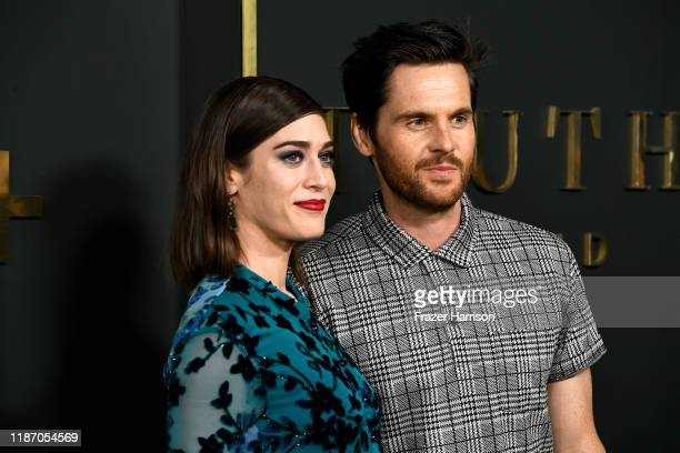 "Lizzy Caplan and Tom Riley attend the Premiere Of Apple TV+'s ""Truth Be Told"" at AMPAS Samuel Goldwyn Theater on November 11, 2019 in Beverly Hills,..."