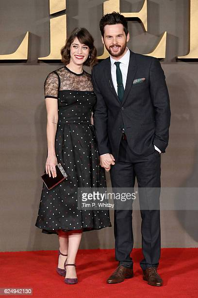 "Lizzy Caplan and Tom Riley attend the UK Premiere of ""Allied"" at Odeon Leicester Square on November 21, 2016 in London, England."