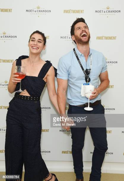 Lizzy Caplan and Tom Riley celebrate with Moet Ice Imperial in the Moet Chandon Suite whilst watching the action unfold on Centre Court at the Aegon...