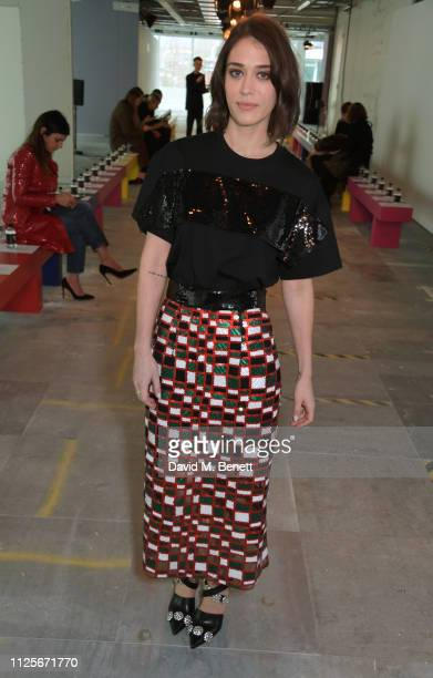 Lizzy Caplan attends the Christopher Kane show during London Fashion Week February 2019 on February 18, 2019 in London, England.