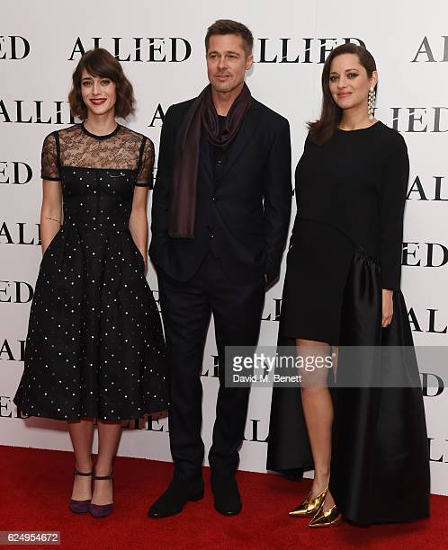 Lizzy Caplan Brad Pitt and Marion Cotillard attend the UK Premiere of 'Allied' at Odeon Leicester Square on November 21 2016 in London England