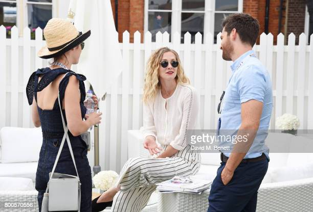 Lizzy Caplan Portia Freeman and Tom Riley celebrate with Moet Ice Imperial in the Moet Chandon Suite whilst watching the action unfold on Centre...