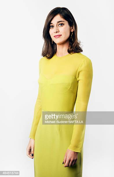 Lizzy Caplan poses for a portrait at the BAFTA luncheon or on August 23, 2014 in Los Angeles, California.