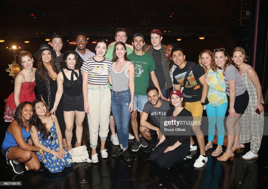 Lizzy Caplan (who played 'Janis Ian' in the 2004 film 'Mean Girls') poses with the cast backstage at the hit musical based on the film 'Mean Girls' on Broadway at The August Wilson Theater on May 26, 2018 in New York City.
