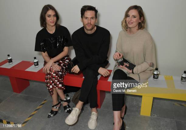 Lizzy Caplan Tom Riley and Laura Carmichael attend the Christopher Kane show during London Fashion Week February 2019 on February 18 2019 in London...
