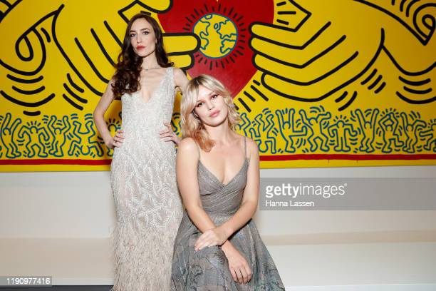 Lizzy Jagger and Georgia May Jagger pose in the Keith Haring | JeanMichel Basquiat Crossing Lines exhibition ahead of the NGV Gala 2019 at the...