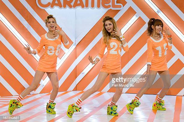 Lizzy Nana and Raina of South Korean girl group Orange Caramel perform during the MBC Music 'Show Champion' on September 18 2012 in Seoul South Korea