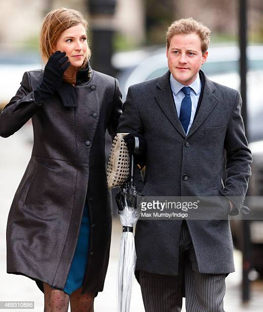 Lizzy Wilson and Guy Pelly attend the wedding of Arabella Musgrave and George GalliersPratt at St Paul's Church Knightsbridge on February 8 2014 in...