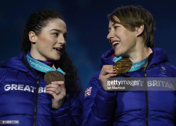 Lizzy Yarnold and Laura Deas of Great Britain pose with their medals from the Women's Skeleton during the Medal Ceremony on day nine of the...