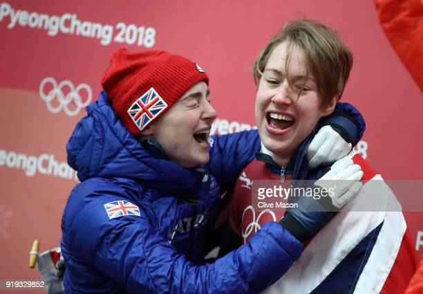 Lizzy Yarnold of Great Britain celebatesas she secures the gold medal with team mate and bronze medalist Laura Deas at the Womens Skeleton on day...