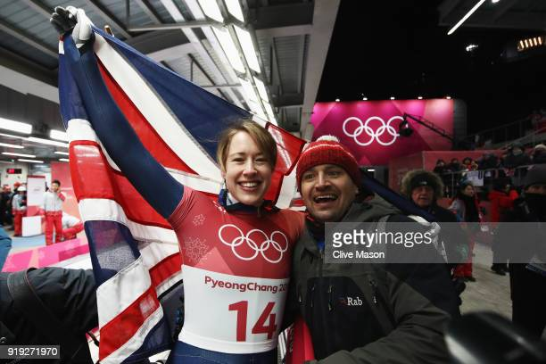 Lizzy Yarnold of Great Britain celebrates as she wins gold with husband James Roche during the Women's Skeleton on day eight of the PyeongChang 2018...