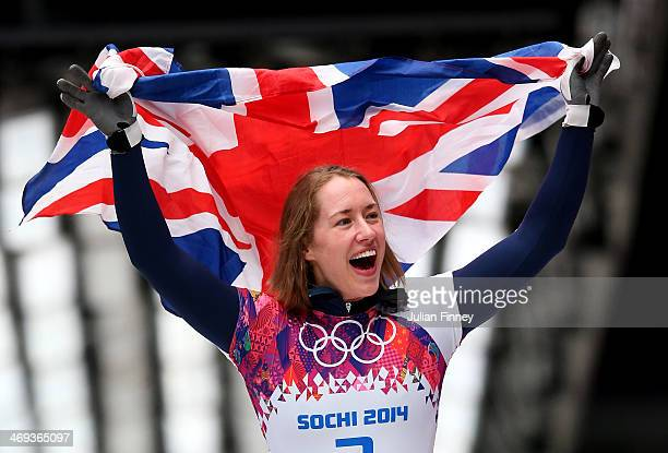 Lizzy Yarnold of Great Britain celebrates winning the gold medal during the Women's Skeleton on Day 7 of the Sochi 2014 Winter Olympics at Sliding...