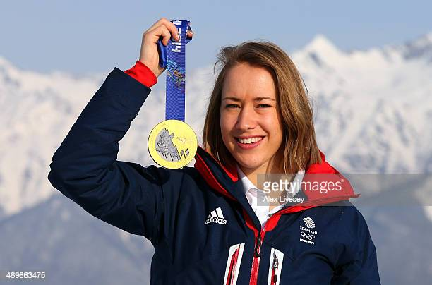 Lizzy Yarnold of Great Britain holds her gold medal after winning the Women's Skelton as she poses for a portrait at the Rosa Khutor mountain village...