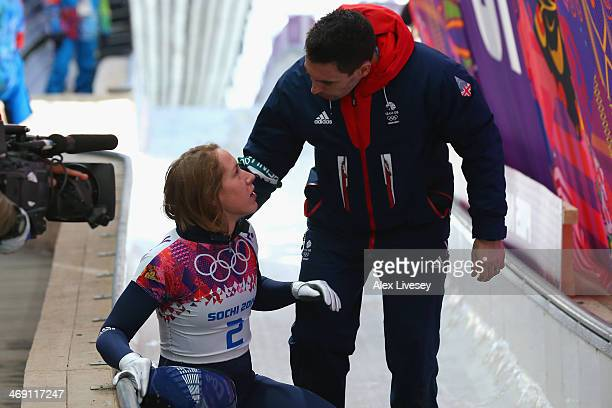 Lizzy Yarnold of Great Britain talks with her coach after a run during the Women's Skeleton heats on Day 6 of the Sochi 2014 Winter Olympics at...