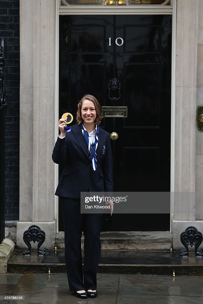 Lizzy Yarnold poses with her Gold medal on the steps of 10 Downing Street on February 25, 2014 in London, England. The Winter Olympic medal winners visited Downing Street today and met with the Prime Ministe David Cameron.