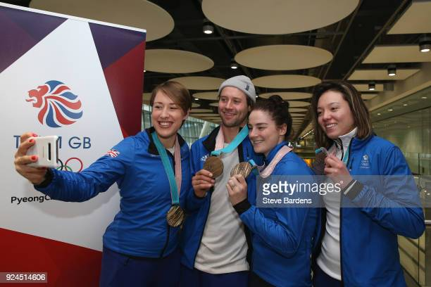 Lizzy Yarnold takes a selfie with Billy Morgan Laura Deas and Isabel Atkin of Great Britain take a selfie with their Olympic medals during the Team...