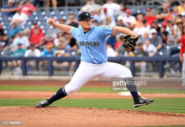 Ljay Newsome of the Seattle Mariners delivers a pitch against the Los Angeles Angels during a spring training game at Peoria Stadium on March 10 2020...