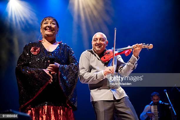 Ljiljana Buttler and violinist Aurel Ionitsa of the band Mahala Rai Banda of Romania perform on stage at the Royal Festival Hall on October 19 2009...