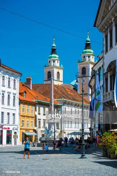 Ljubljana Cathedral or St. Nicholas's Church and Fountain of the Three Carniolan Rivers. Ljubljana, Slovenia, Europe.