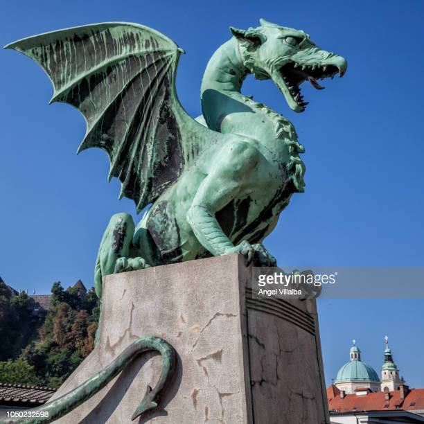 ljubljana. one of the dragons of the bridge of the dragons - ljubljana stock pictures, royalty-free photos & images