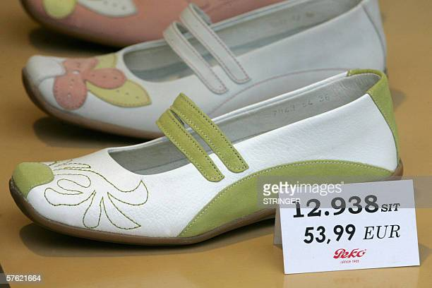 The prices in Slovenian tolars and in euros are displayed in a shoe shop in Ljubljana 16 May 2006The EU Commission and the European Central Bank will...