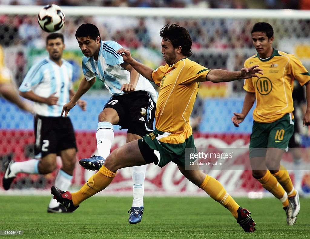 Ljubo Milicevic of Australia fight for the ball with Juan Riquelme of Argentina during the FIFA Confederations Cup 2005 match between Argentina and Australia on June 18, 2005 in Nuremberg, Germany.