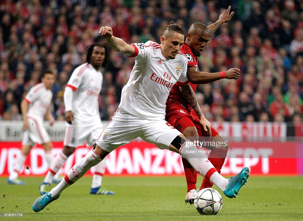 Ljubomir Fejsa of Benfica and Douglas Costa of Bayern Munich battle for the ball during the UEFA Champions League quarter final first leg match between FC Bayern Muenchen and SL Benfica at Allianz Arena on April 5, 2016 in Munich, Germany.
